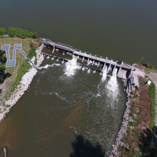 Aerial view of the dam with fish ladder